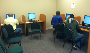 Clients use the newly installed computer  learning lab at River Edge's Emery Highway  location. A Health IT grant from SAMHSA funded the lab at Emery, River Edge's other outpatient  locations and sites at View Point Health.